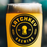 Latchkey Beer logo glass